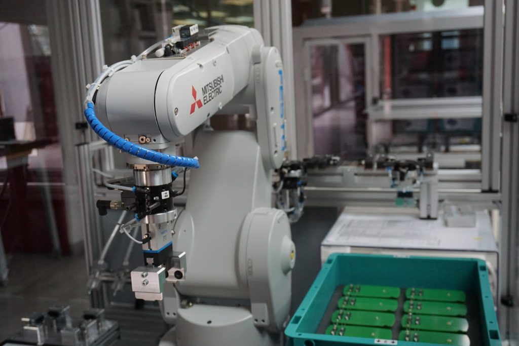 How can artificial intelligence transform manufacturing?